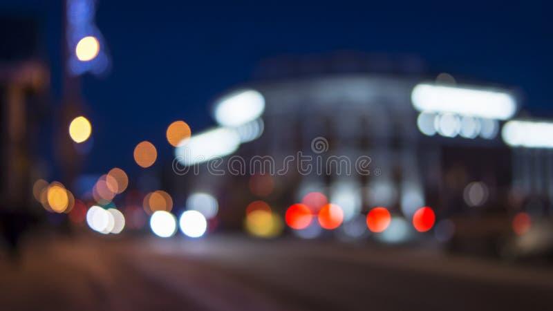 Evening city street bokeh lights in winter. Evening city street lights in winter. Petrozavodsk city, Karelia stock photos