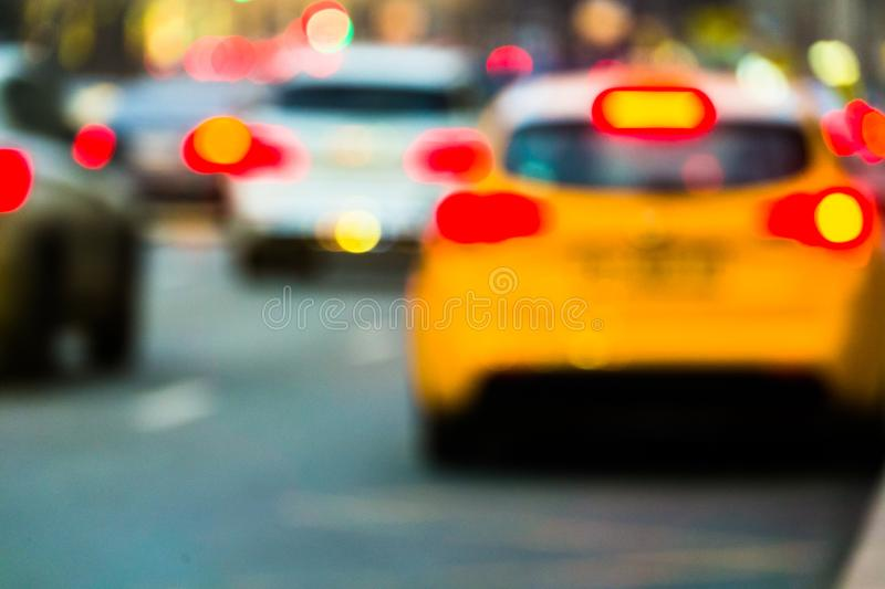 Evening city traffic in a giant metropolis.City light bokeh background.Defocused night traffic lights. stock photography
