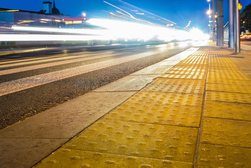 Evening city traffic jam tactile tile yellow close up stock image