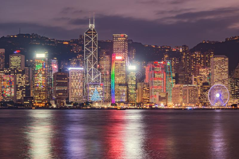 Evening city view of Hong Kong island. Buildings have illumination for Christmas and New Year holiday stock images