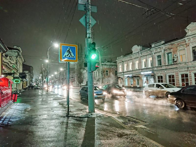 Evening cityscape in rainy weather. Cars and night lights. City of Saratov, Russia.  stock photo