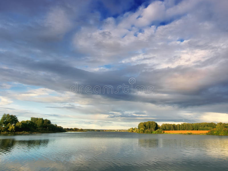 Download Evening clouds above lake stock image. Image of fresh - 21243453