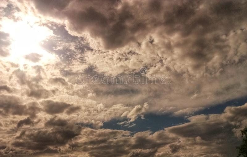 the evening clouds with the glow of the sun stock photo