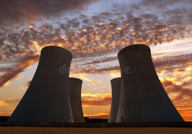 Evening colored view of cooling tower - Nuclear power. Plant stock photography