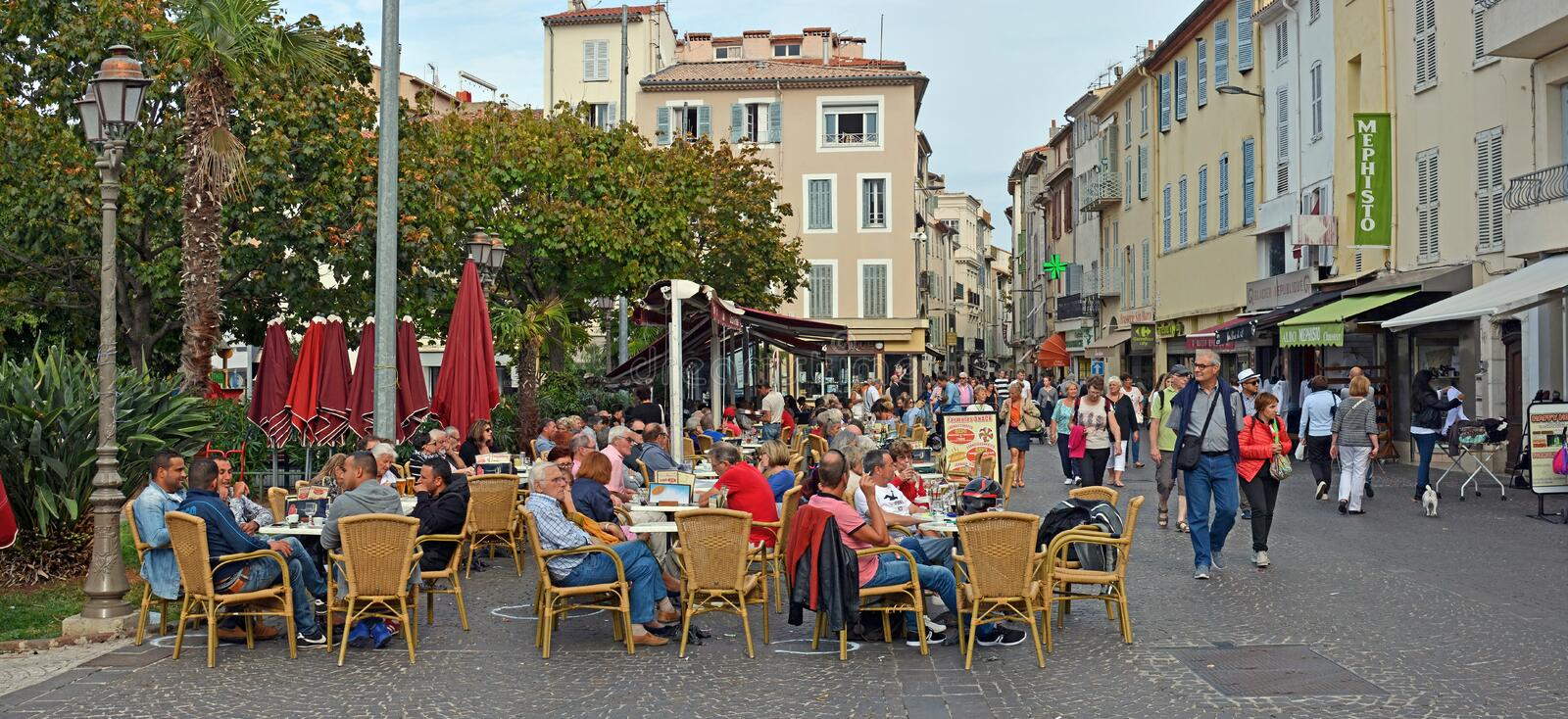 An evening drink at an Antibes Square Cafe, Provence France royalty free stock photos