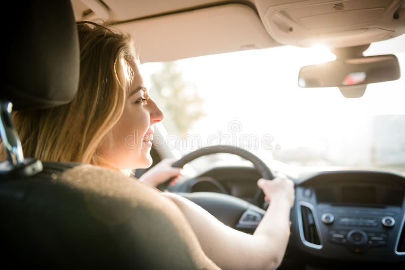 Evening drive - teenager at car stock image