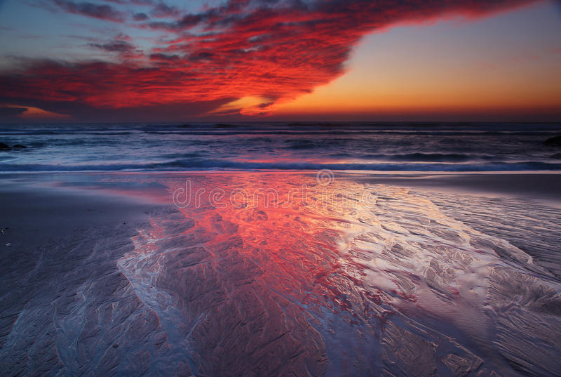 Evening of fire. Terrific sky. Sunset in guincho beach, Portugal stock images
