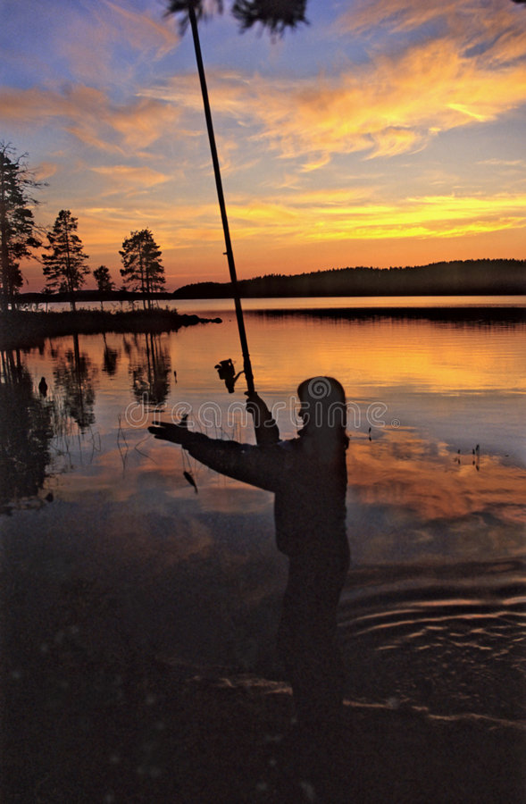 Evening. Fishing at the lake. stock photography