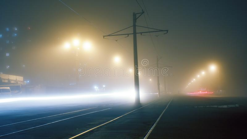 Evening fog on the streets of Dneprodzerzhinsk. Fog on the streets stock image