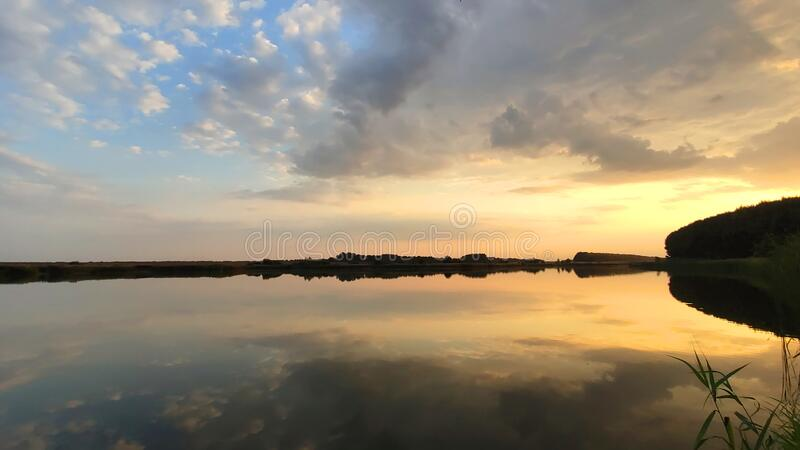 Evening on the forest lake royalty free stock image