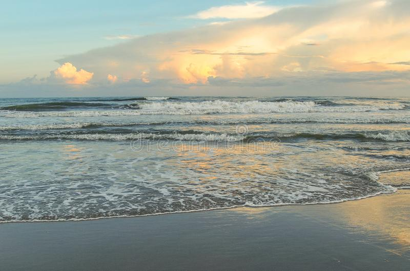 Evening Glow at Atlantic Beach, North Carolina. Setting sun shines off of the waves and water in Atlantic Beach, North Carolina stock photo