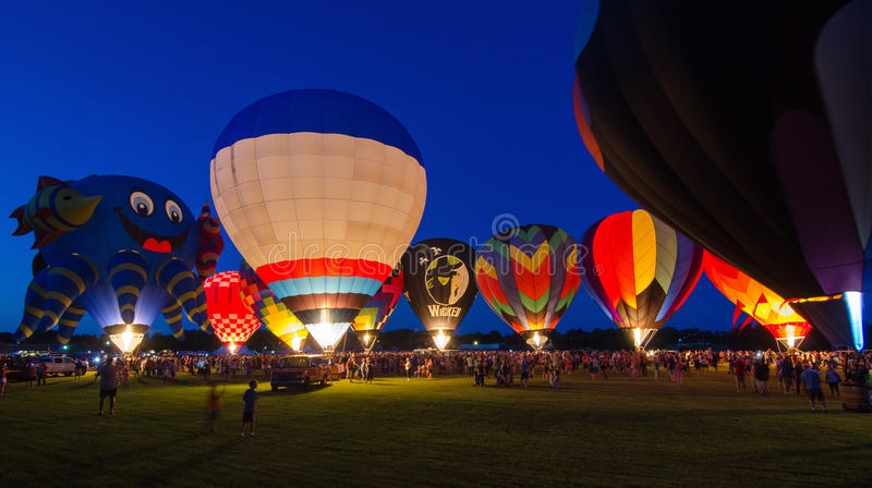 Evening Glow Hot Air Balloon Festival. An evening glow spectator event at the 2015 Hot Air Balloon Festival in Waterford, Wisconsin stock image
