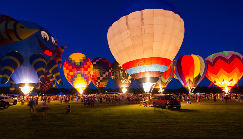 Evening Glow Hot Air Balloon Festival. An evening glow spectator event at the 2015 Hot Air Balloon Festival in Waterford, Wisconsin royalty free stock images