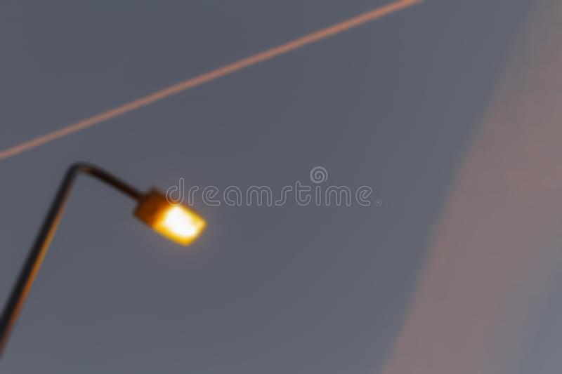 Evening golden hours blue sky with street lantern clouds and orange condensation trails of planes.  royalty free stock photos