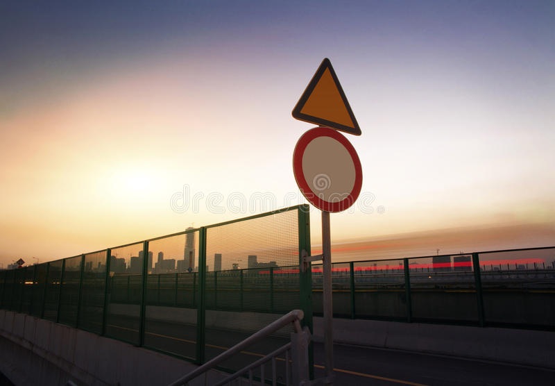 In the evening, highway signs. A close-up of road traffic signs royalty free stock images