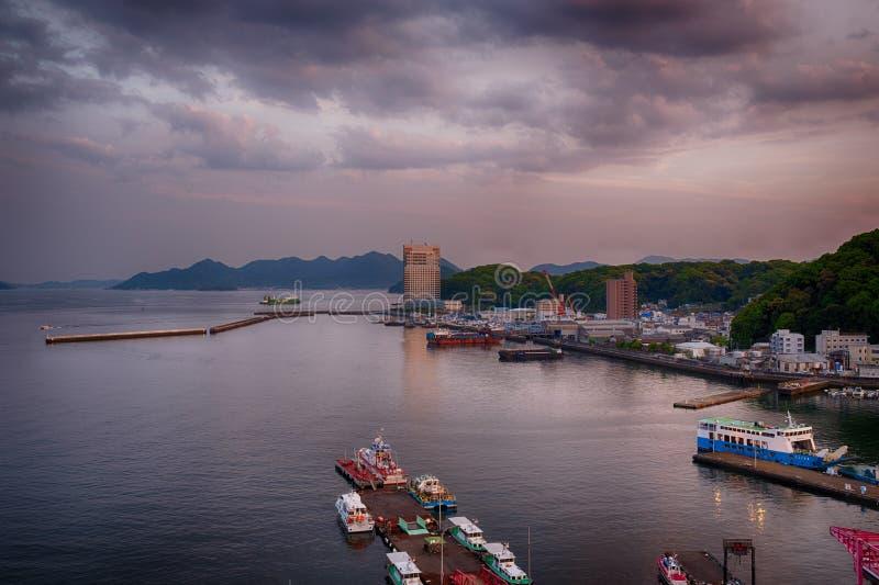 Evening on Hiroshima port and bay, Japan. Cloudy evening on Hiroshima port and bay, Japan royalty free stock photos