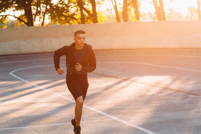 Evening jog of professional athlete, sunset light royalty free stock images