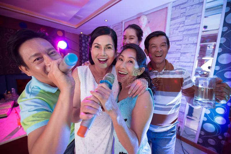 Evening in karaoke stock photos