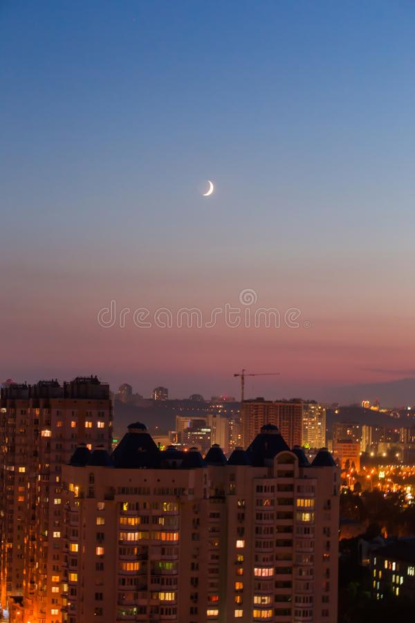 Evening in Kiev, a top view city, the night streets and the new moon in the sky.  stock images