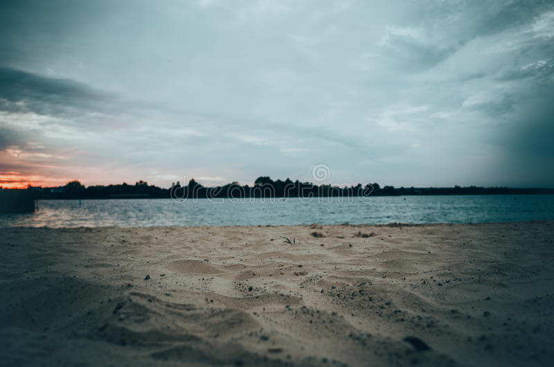 Evening lake beach stock photography