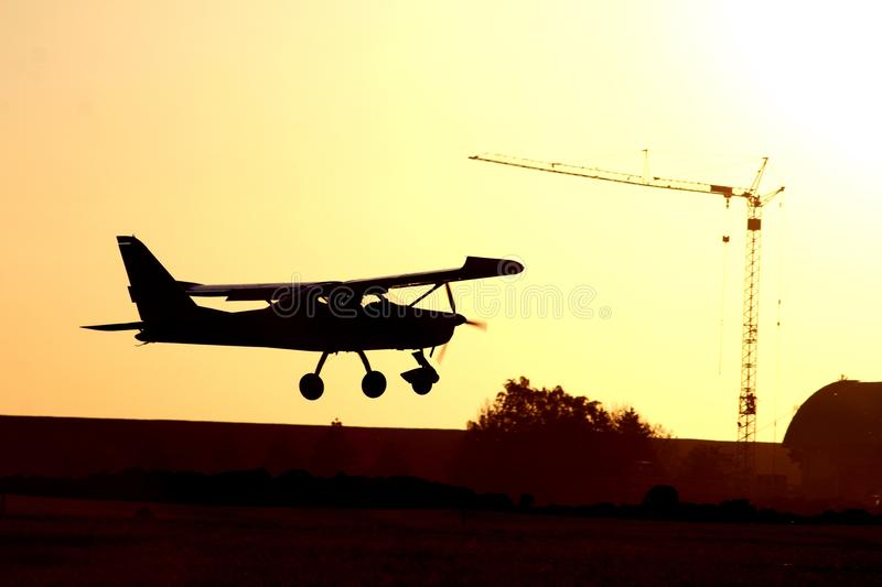 Airplane shadow and crayn stock photography