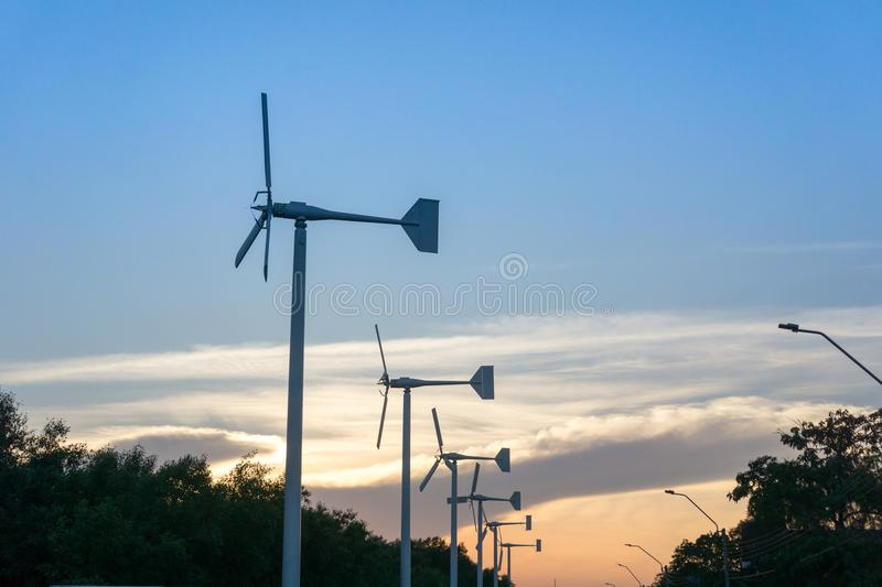 Evening landscape of wind turbine windmills for electric power production royalty free stock photo