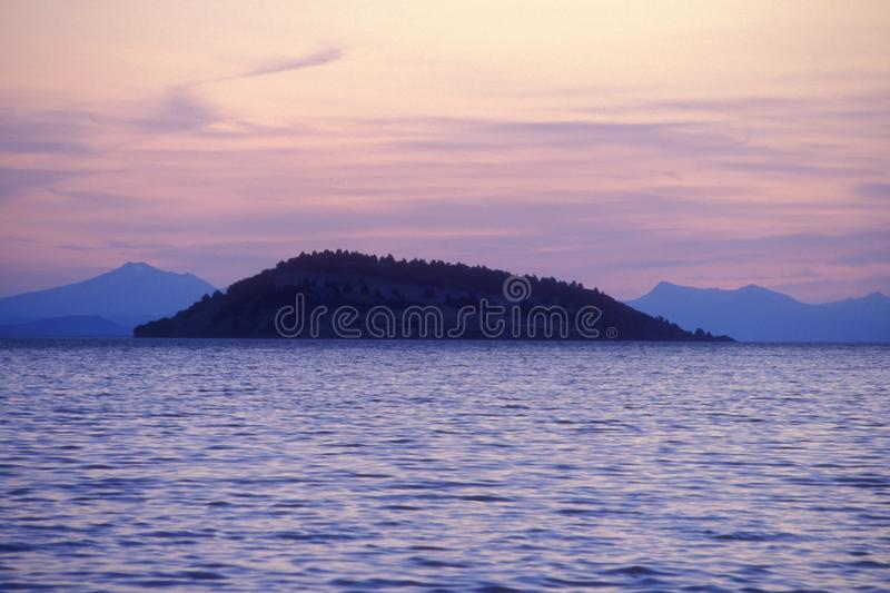 Evening Light on Buck Island. Buck Island bathed in evening light as the sun is setting.  This island sits in Upper Klamath Lake located in Klamath Falls, Oregon stock photography