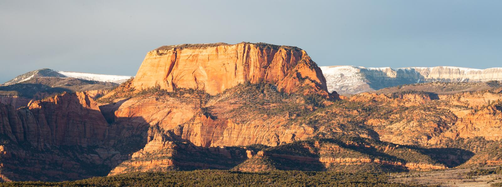Evening light on Burnt mountain and Kolob fingers with snow on the plateau behind them. Burnt mountain and Kolob fingers glow in the evening light of a winter stock photography