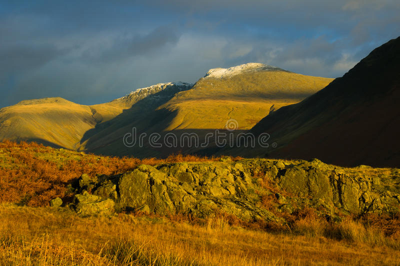 Evening light catching Wasdale. Evening light catching Easdale in Cumbria stock photo