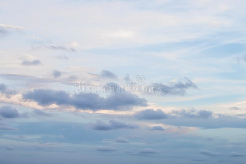 Evening light with clouds and blue sky.  stock photography