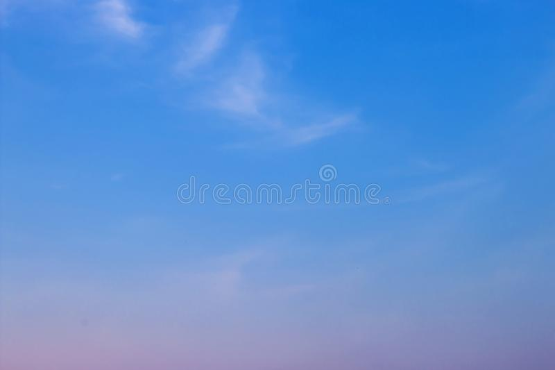Evening light with clouds and blue sky.  stock photo