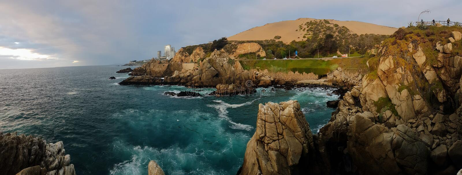Evening light at the coast. Sea, tuquis, turquise, water, rocks, chile, valparaiso, travel, sunset royalty free stock photo