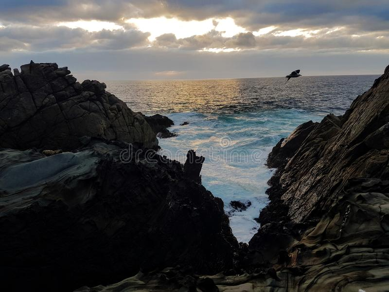 Evening light at the coast. Sea, tuquis, turquise, water, rocks, chile, valparaiso, travel, sunset stock image
