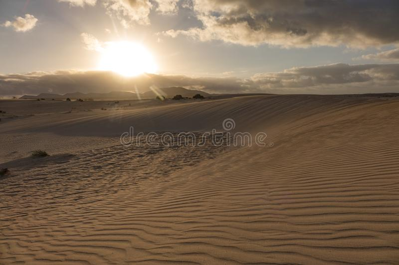 Sun setting over the mountains In the Natural Park Corralejo Fuerteventura Canary Islands Spain royalty free stock photo