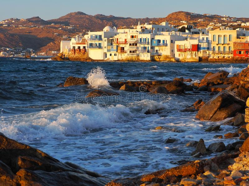 Evening light in Little Venice, Mykonos Island, Greece. In  , mykonos island, littlevenice, blue, sky, beach, wave, sea, ocean, geek, sunset, rock, splash royalty free stock photography
