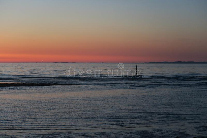 Evening light during low tide. Evening on a beautiful beach in the Netherlands, low tide royalty free stock photography