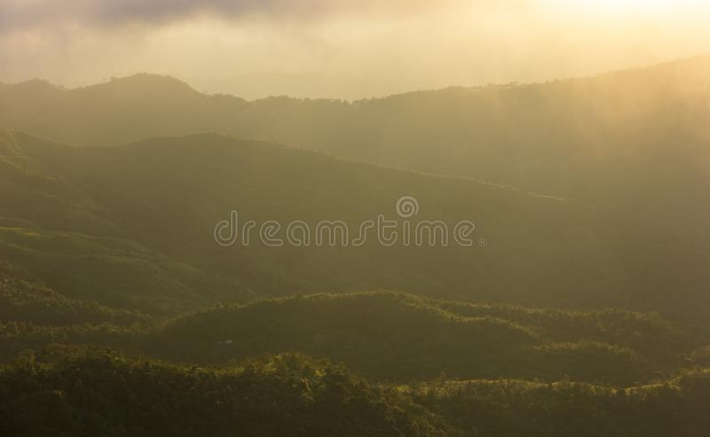Evening light over the green hills surrounding the city of Lunglei in Mizoram in Northeast India stock photos