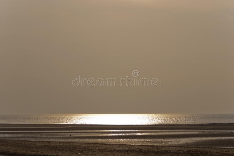 Evening. Light reflected off the sea, Norfolk, England royalty free stock image