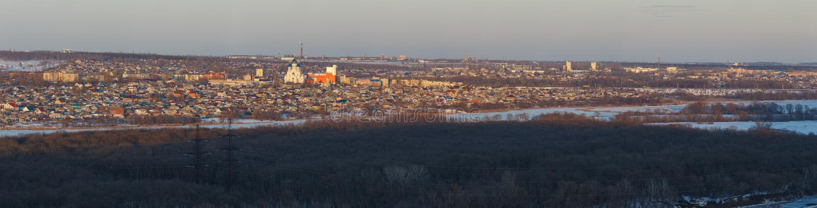 Evening lighting over the city. Sunset time in the twilight sky. Panoramic top view of residential district,. Evening lighting over the city. Sunset time in the stock photos