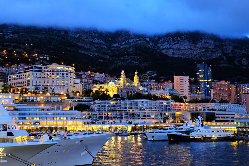 Evening lights of Monaco, view from the sea stock image