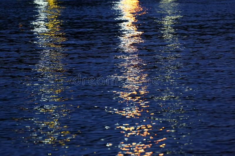Evening lights reflection. Reflection of evening lights in sea water royalty free stock photo
