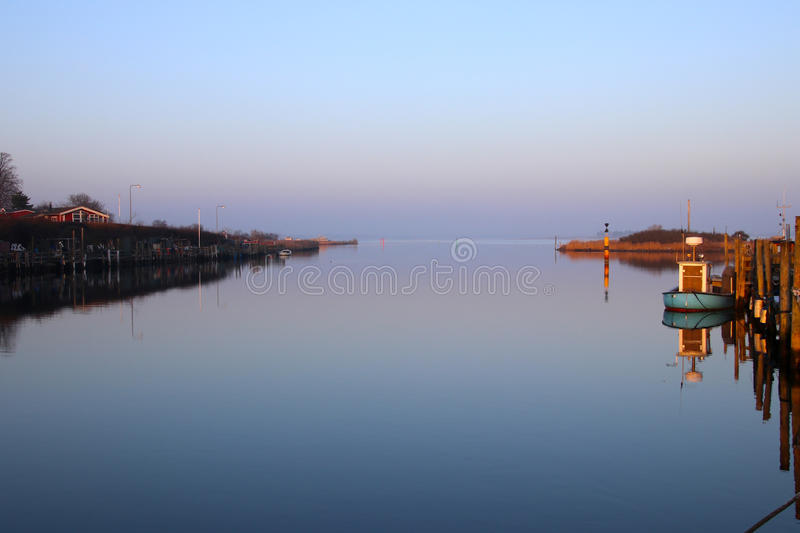 Evening mood at he small harbor so nice royalty free stock photos