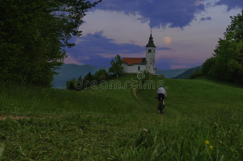 Evening mountain bike ride. And full moon royalty free stock photo