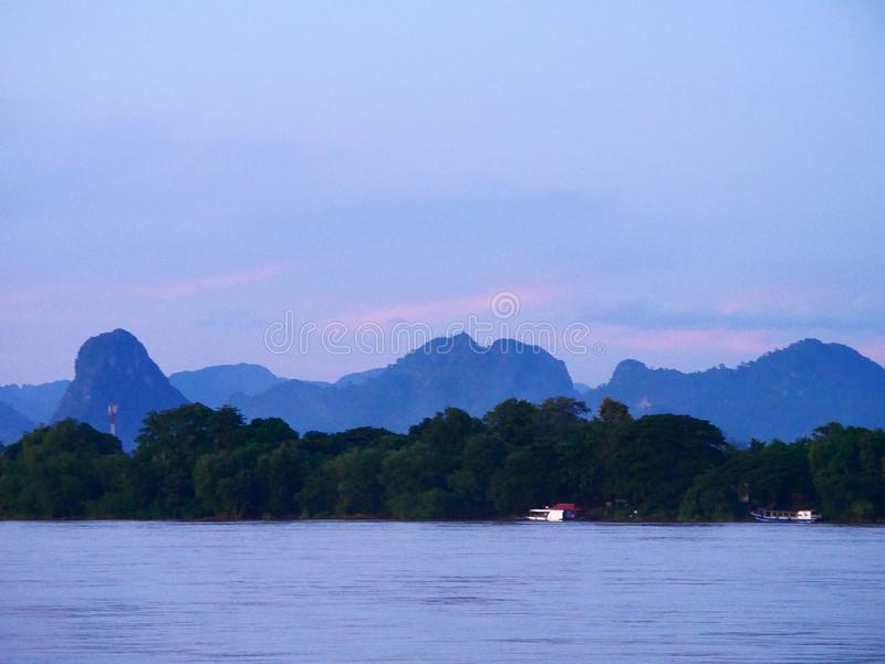Evening mountain river side Mekong River. Evening mountain waterfront river side Mekong River at Naklorn Phanom in Thailand and Laos royalty free stock photo