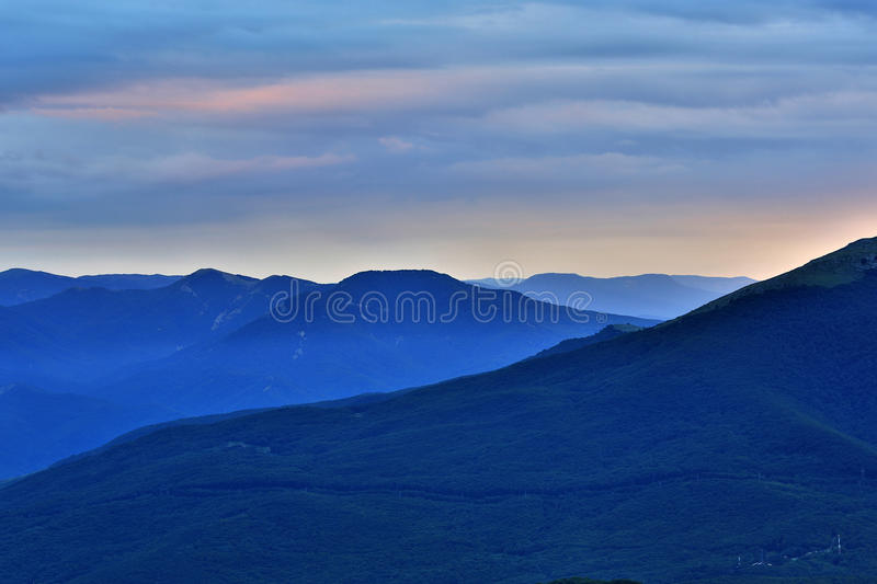 Evening in mountains stock images