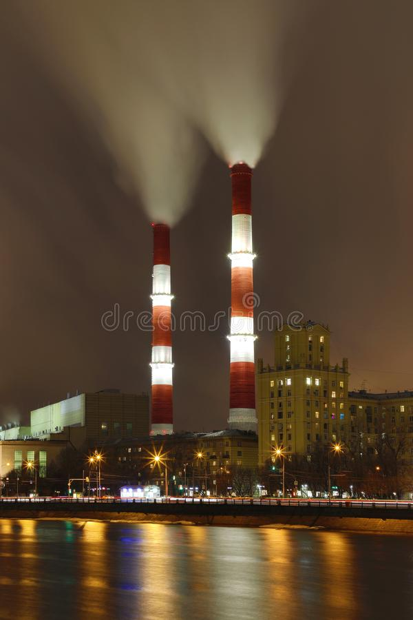 The evening or night view on the thermal power station on the Moskva river embankment in Moscow royalty free stock images