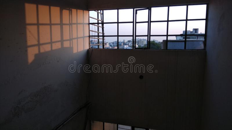Evening orange light from window. Evening orange light from a window in an old building royalty free stock images