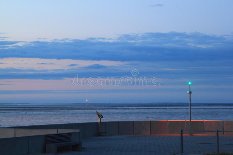 Evening over mudflat. At the german north sea coast, neuharlingersiel royalty free stock photo