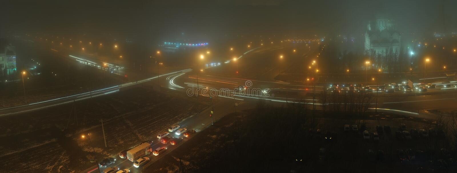 Evening panorama of the city of Togliatti, wrapped in dense fog. stock photography