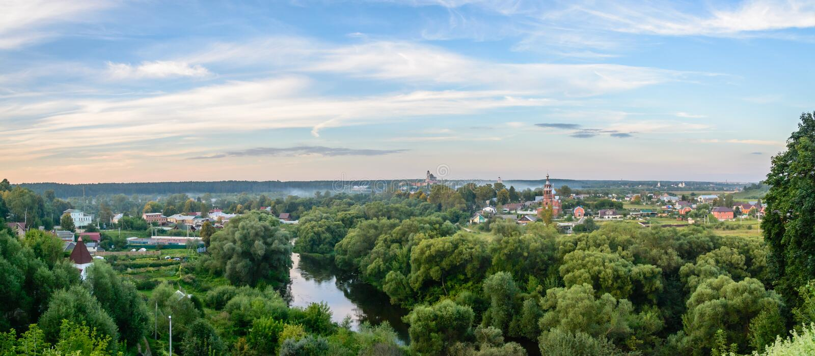 Evening panorama of Russian city with a river and churches stock photos
